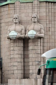 Monumental figures carved into the facade of the main train station.